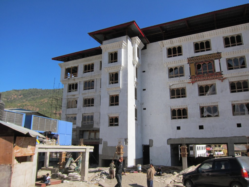The Oberoi is building a hotel in central Thimpu. One window is painted to show how the exterior will ultimately look.